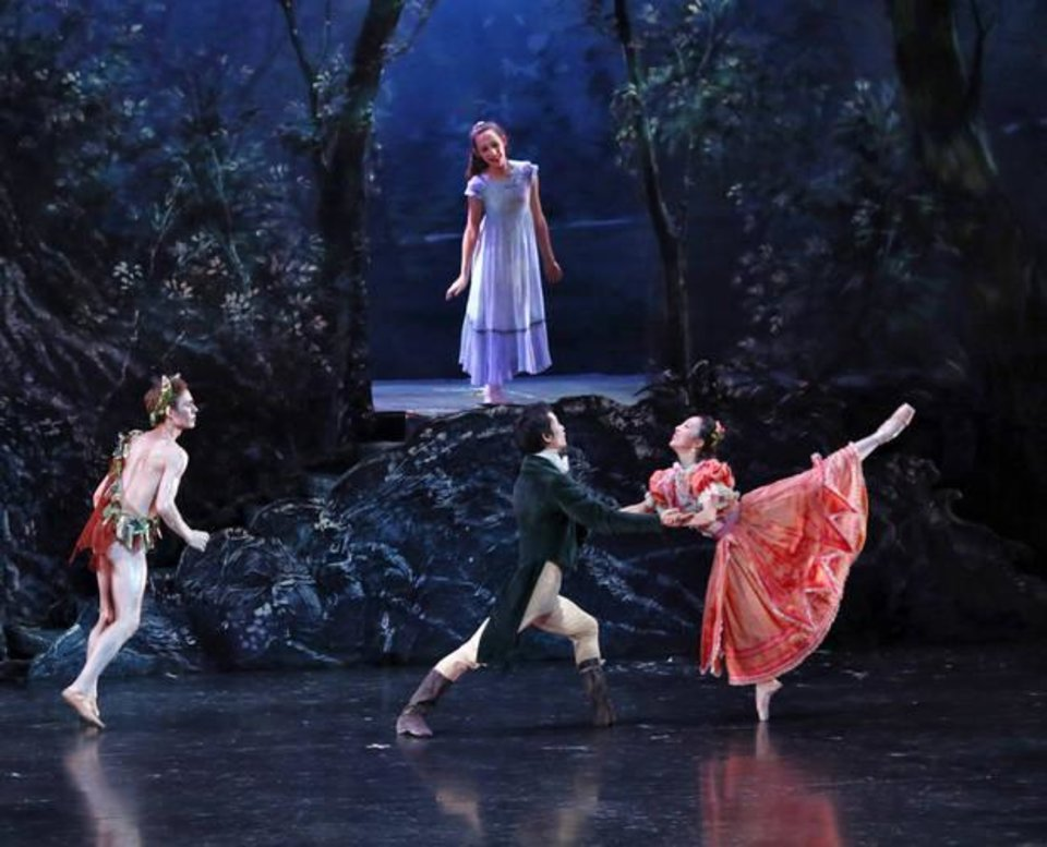 Photo - Oklahoma City Ballet soloist Walker Martin plays Puck, left, student dancer Hannah White plays the changeling child, principal dancer Yui Sato plays Lysander and DaYoung Jung plays Hermia in an ArtsReach performance of