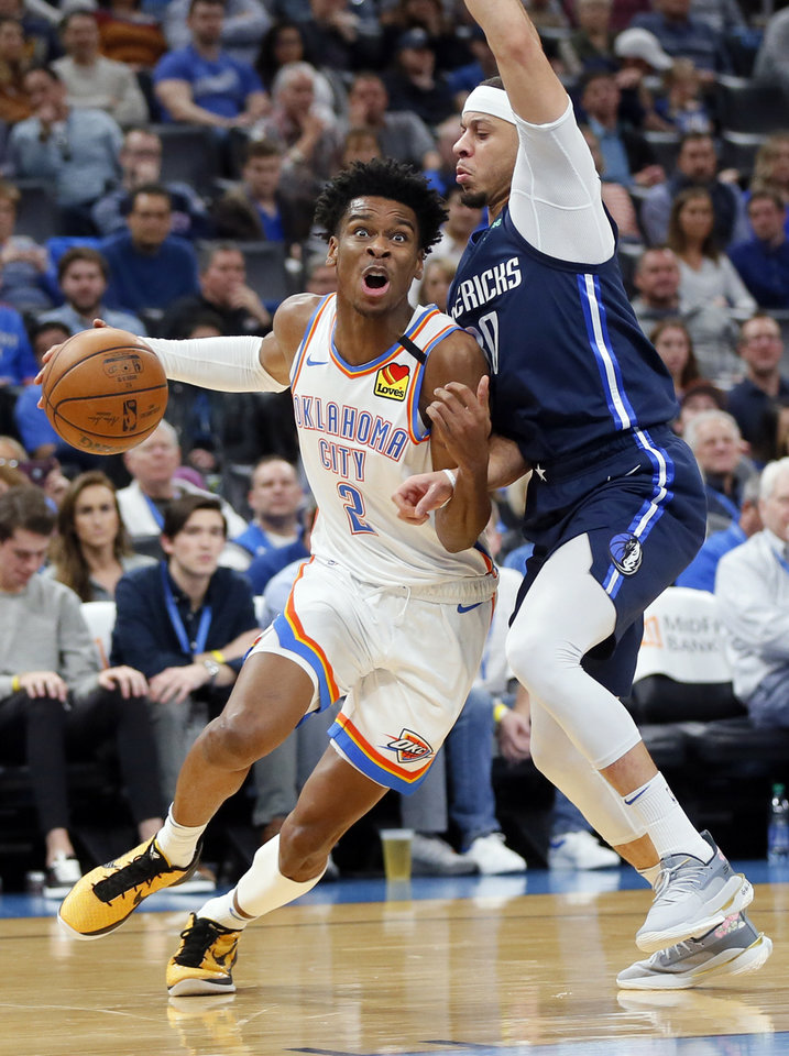 Photo - Oklahoma City's Shai Gilgeous-Alexander (2) drives as Dallas' Seth Curry (30) defends in the second quarter during an NBA basketball game between the Oklahoma City Thunder and Dallas Mavericks at Chesapeake Energy Arena in Oklahoma City, Monday, Jan. 27, 2020. [Nate Billings/The Oklahoman]