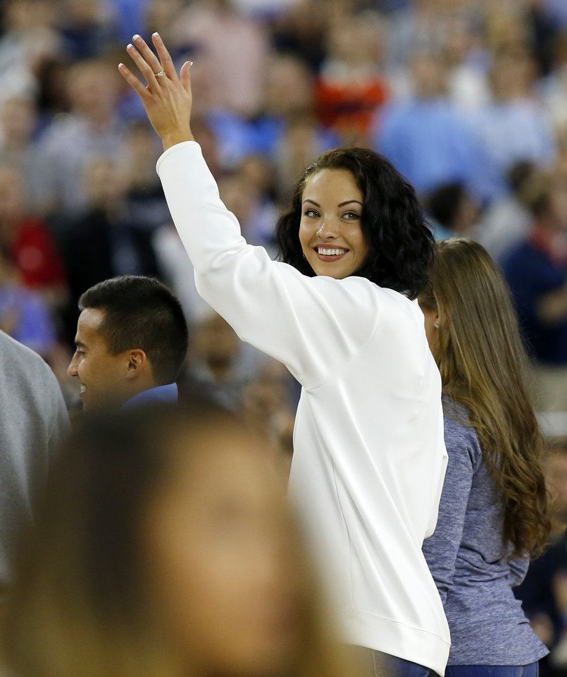 Photo - Oklahoma volleyball player Madison Ward waves to the crowd before singing the national anthem prior to the national semifinal between the Oklahoma Sooners (OU) and the Villanova Wildcats in the Final Four of the NCAA Men's Basketball Championship at NRG Stadium in Houston, Saturday, April 2, 2016. Photo by Nate Billings, The Oklahoman