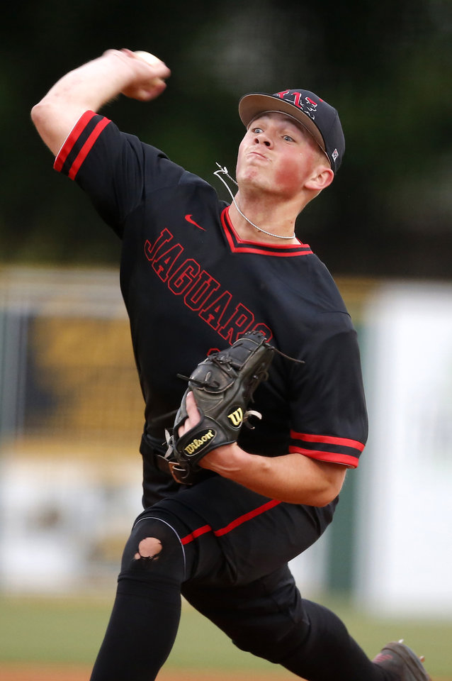 Photo - Westmoore's Kale Davis throws a pitch during a high school baseball game between Westmoore and Norman at Westmoore High School in Moore, Okla., Tuesday, April 16, 2019. Photo by Sarah Phipps, The Oklahoman