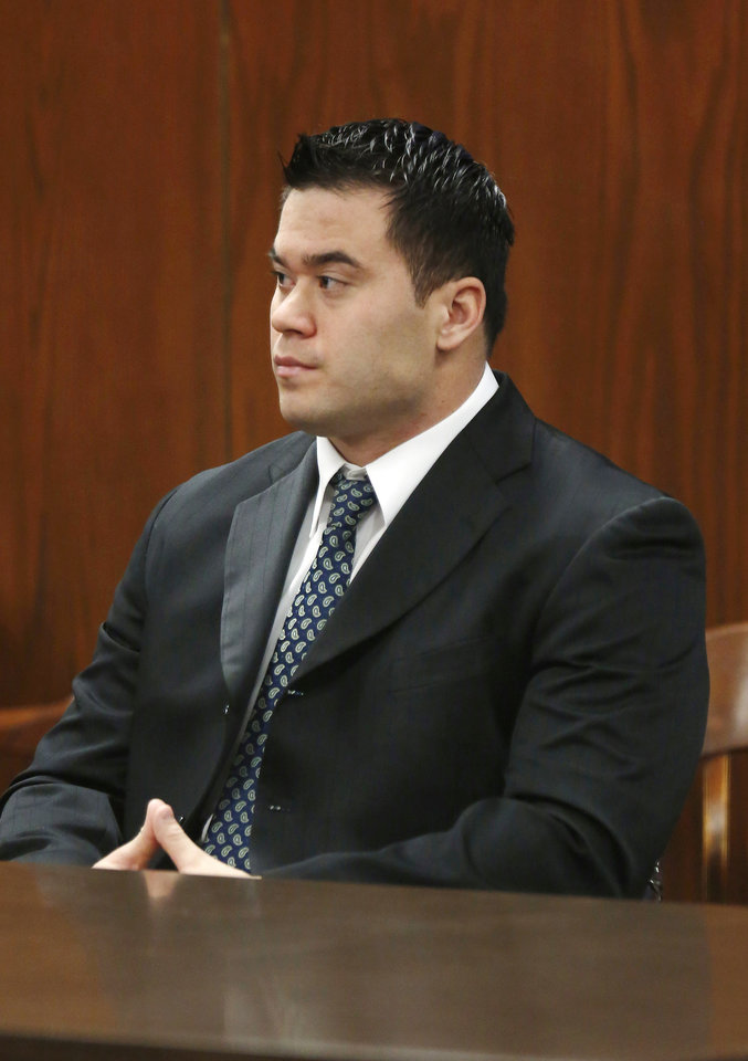 Photo - Oklahoma City police officer Daniel Holtzclaw sitting in the courtroom for a bail hearing at the Oklahoma County Courthouse in Oklahoma City, Wednesday  October 2, 2014.  Photo by Paul B. Southerland, The Oklahoman