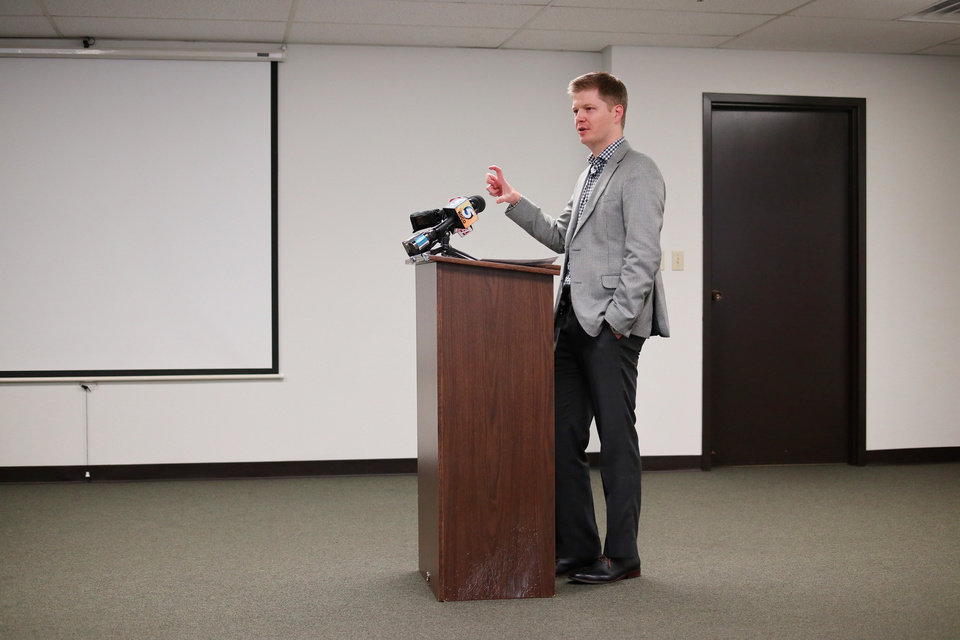 Photo -  Tyler Laughlin, deputy commissioner at the Oklahoma Insurance Department, speaks during a news conference Tuesday. [Photo by Doug Hoke, The Oklahoman]