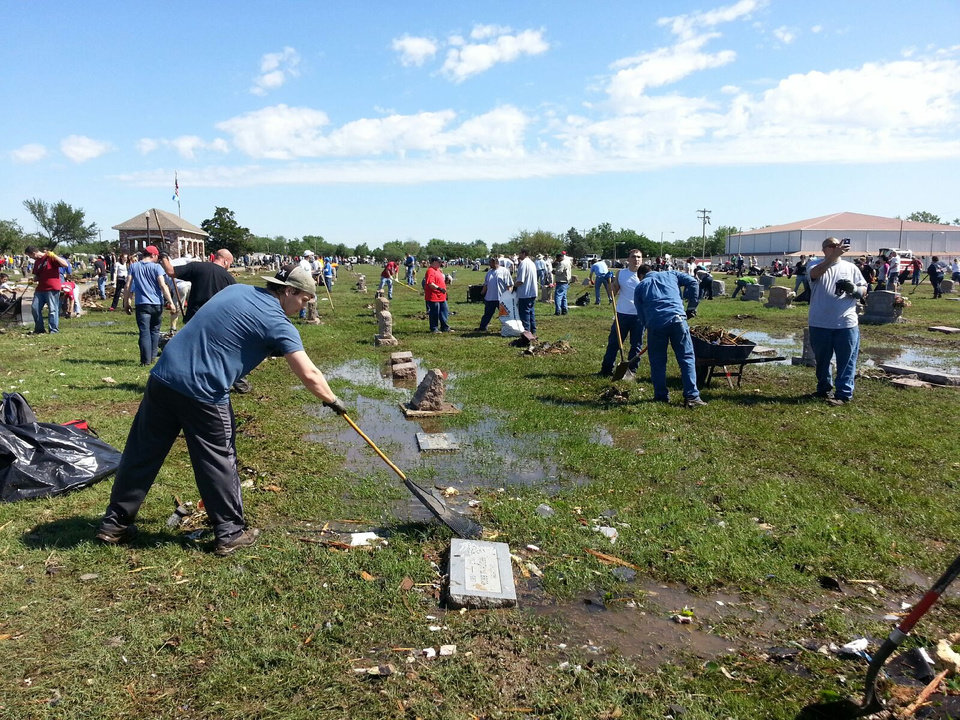 Photo - Volunteers clean the Moore Cemetery of debris following this week's violent tornado. PHOTO BY ED GODFREY, THE OKLAHOMAN