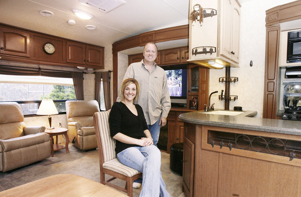 Photo - Richard and Michelle Bercher gave up their 2,000-square-foot house for a new home in their 385-square-foot fifth-wheel so they can prepare to travel when he retires in two years. PHOTO BY PAUL HELLSTERN, THE OKLAHOMAN