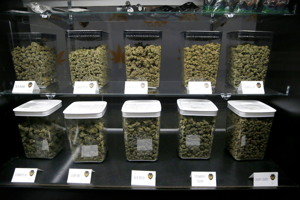 Photo -  Cannabis is stored on shelves at the Okie Kush Club in Oklahoma City.