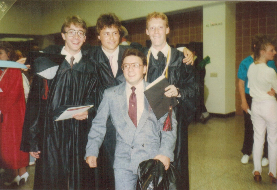 Photo -  Jim, center, poses with Ken Raymond and two of their  friends after commencement at Ken's school.