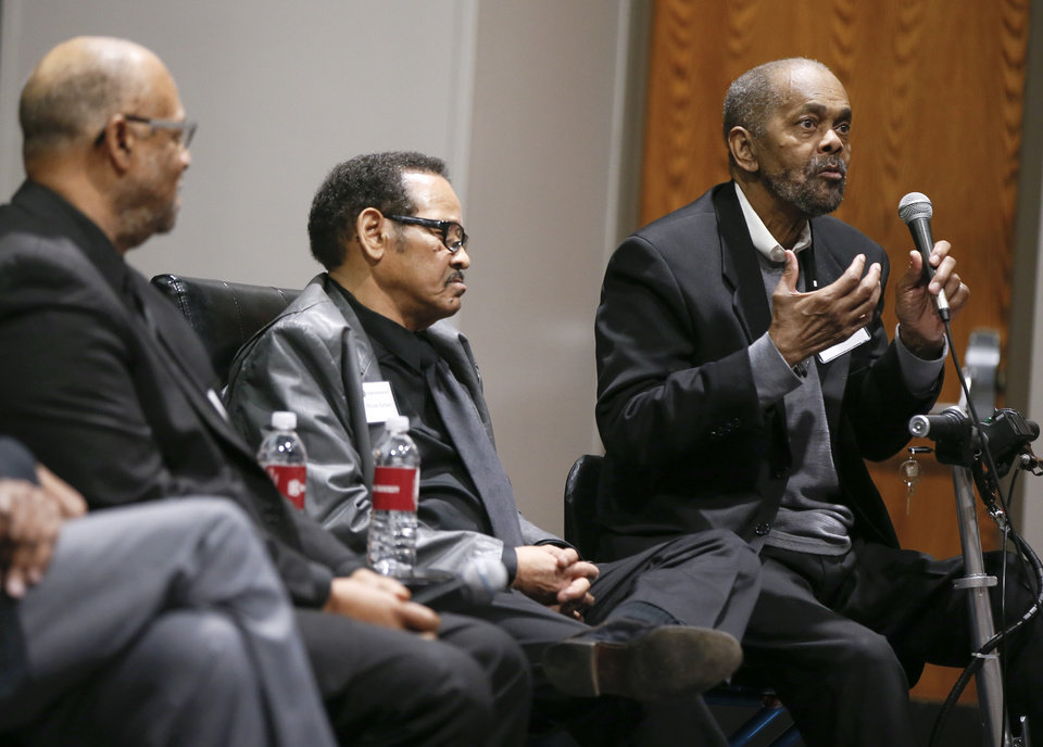 Photo - Ron Wright, right, talks next to Michael Baldwin, middle, and Robert Edison, left, during a panel discussion with former students who were expelled from then Oklahoma Christian College and arrested in 1969 after the Benson Hall sit-in to protest the expulsion of black basketball players who were accused of attending an interracial gathering off campus, at Oklahoma Christian University's Judd Theatre in Oklahoma City, Wednesday, March 6, 2019. Wright, Baldwin and Edison are part of what OC now calls Oklahoma Christian's 18. Photo by Nate Billings, The Oklahoman