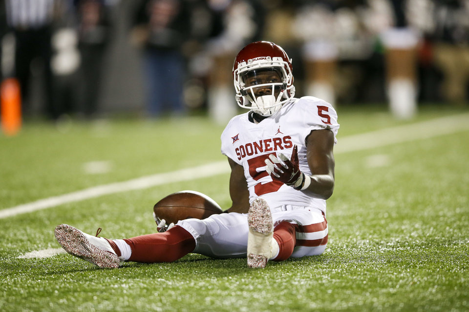 Photo - Oklahoma Sooners wide receiver Marquise Brown (5) reacts after dropping a pass during the NCAA football game between the Texas Tech Red Raiders and the Oklahoma Sooners at Jones AT&T Stadium in Lubbock, Texas on Saturday, November 03, 2018. IAN MAULE/Tulsa World
