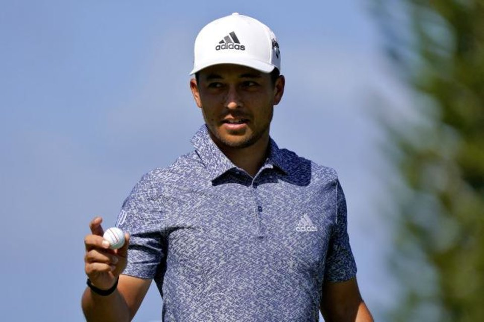 Photo - Xander Schauffele acknowledges the gallery on the second green during final round of the Tournament of Champions golf event, Sunday, Jan. 5, 2020, at Kapalua Plantation Course in Kapalua, Hawaii. (AP Photo/Matt York)