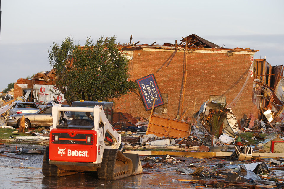 Photo - Tornado damage to the American Budget Value Inn is seen in El Reno, Okla., Sunday, May 26, 2019. [Bryan Terry/The Oklahoman]