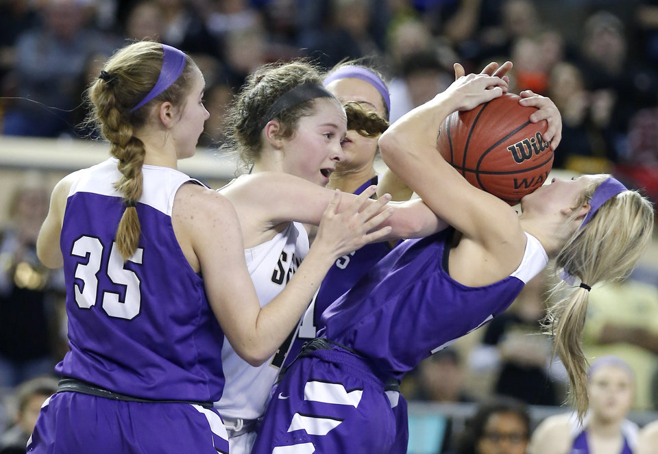 Photo - Hydro-Eakly's Kira Berkey and Kalyn Yancey, right, fight Seiling's Asia Pellegrina for a ball during the Class A girls state high school basketball championship game at Jim Norick State Fair Arena, the Big House, at State Fair Park in Oklahoma City, Saturday, March 2, 2019. Photo by Sarah Phipps, The Oklahoman