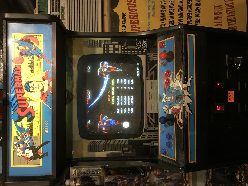 Photo -  A Superman video game cabinet is on display at the Super Museum.  [photo by Matthew Price, The Oklahoman]