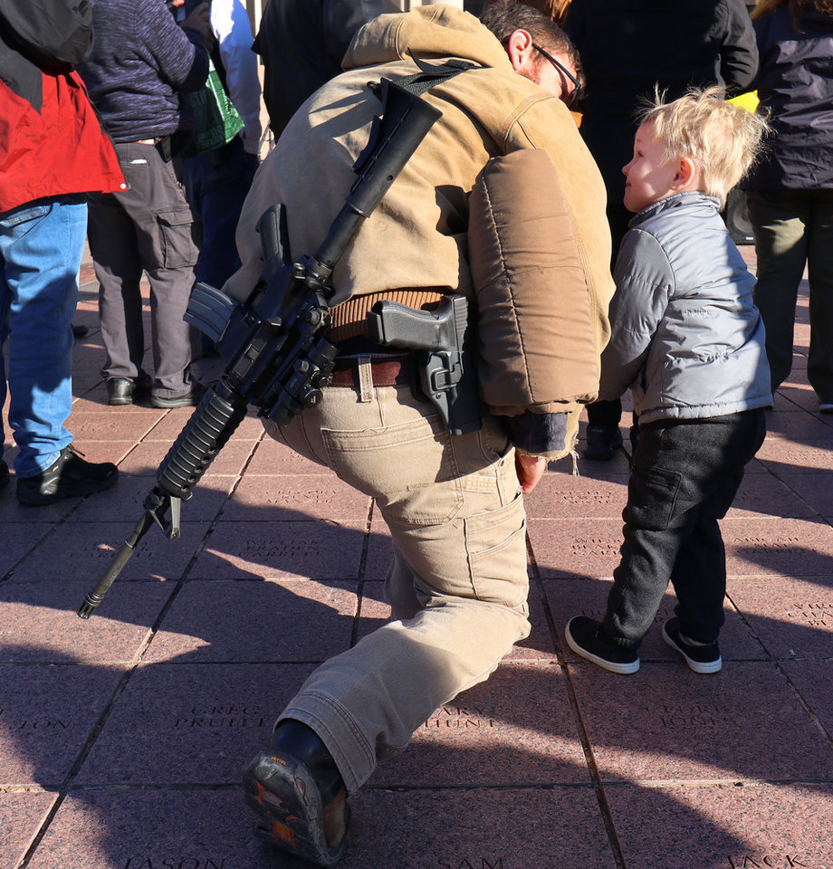 Photo - Logan West and his son, Nathaniel, 3, from Cleveland. Second Amendment supporters rally at the state Capitol to celebrate the permitless carry law taking effect. Friday, November 1, 2019. [Doug Hoke/The Oklahoman]
