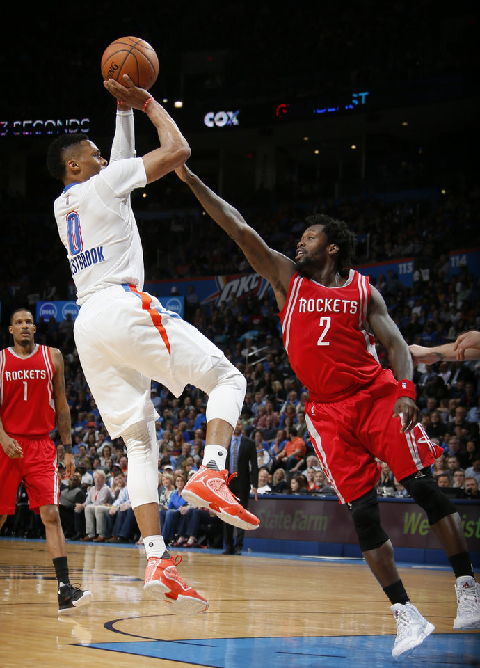 Photo - Oklahoma City's Russell Westbrook (0) shoots over Houston's Patrick Beverley (2) during an NBA basketball game between the Oklahoma City Thunder and the Houston Rockets at Chesapeake Energy Arena in Oklahoma City, Tuesday, March 22, 2016. Photo by Bryan Terry, The Oklahoman