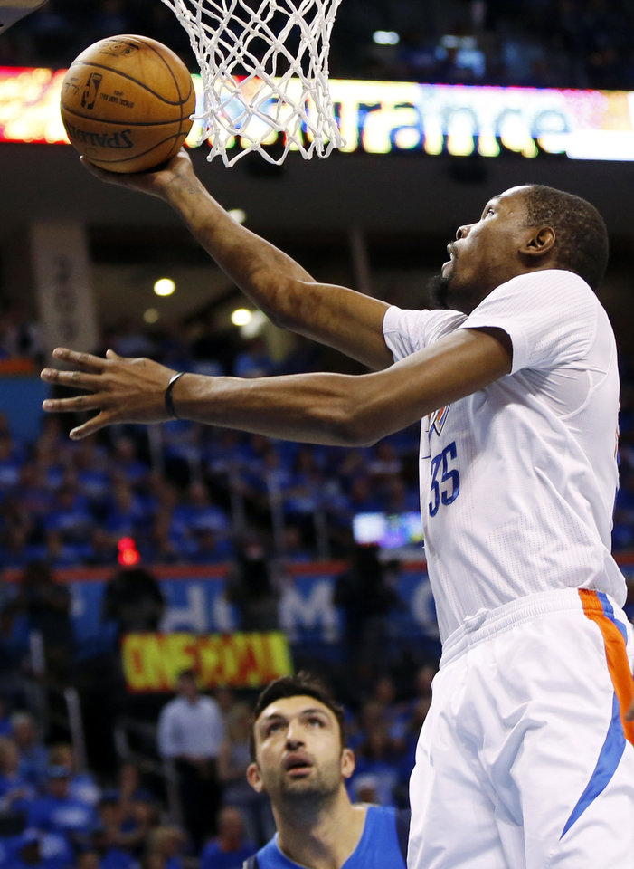 Photo - Oklahoma City's Kevin Durant (35) shoots next to Dallas' Zaza Pachulia (27) during Game 5 of the first round series between the Oklahoma City Thunder and the Dallas Mavericks in the NBA playoffs at Chesapeake Energy Arena in Oklahoma City, Monday, April 25, 2016. Photo by Nate Billings, The Oklahoman