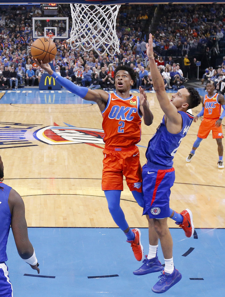 Photo - Oklahoma City's Shai Gilgeous-Alexander (2) goes to the basket past LA's Landry Shamet (20) during an NBA basketball game between the Oklahoma City Thunder and the LA Clippers at Chesapeake Energy Arena in Oklahoma City, Sunday, Dec. 22, 2019. Oklahoma City won 118-112. [Bryan Terry/The Oklahoman]