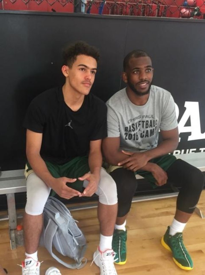 Photo -  Trae Young, left, was a frequent visitor growing up to Chris Paul's basketball camp in North Carolina. [PHOTO PROVIDED]