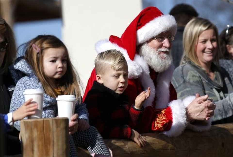 Photo -  Santa Claus joins guests as they watch animals eat enrichment gifts Friday at The Oklahoma City Zoo and Botanical Garden.  [Sarah Phipps/The Oklahoman]