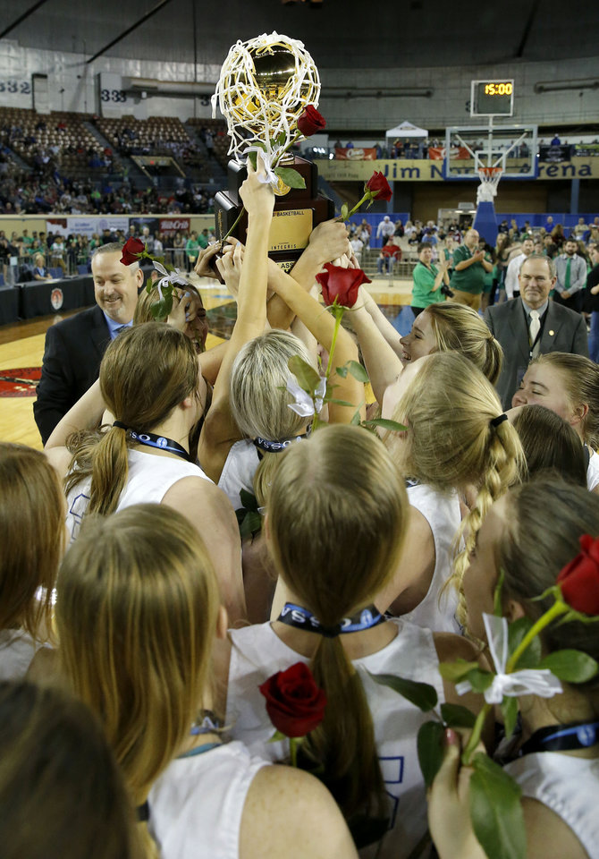 "Photo - Lomega celebrates with the trophy after winning the Class B girls state basketball tournament championship game between Lomega and Varnum inside Jim Norick Arena, ""The Big House,"" at the OKC Fairgrounds in Oklahoma City, Saturday, March 7, 2020. [Bryan Terry/The Oklahoman]"