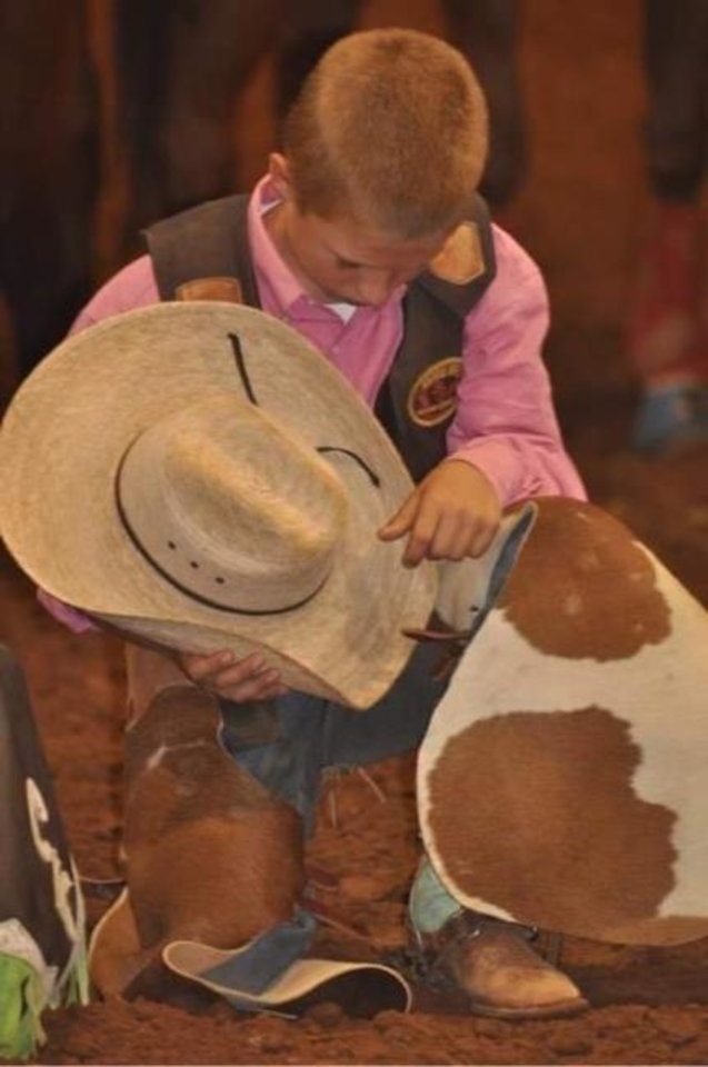 Photo -  Rowdy Swanson is shown at age 10 or 11 at the Midsouth Rodeo Cowboys Association Finals. [PHOTO PROVIDED}