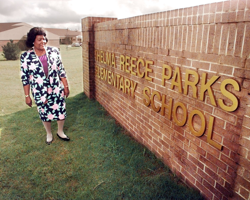 Photo - Thelma Parks in front of school.