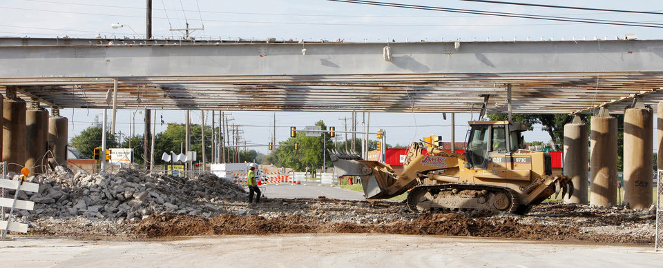 Photo - Workers remove the old I-40 Crosstown Expressway near SW 3 and Harvey in downtown Oklahoma City.   PAUL B. SOUTHERLAND - PAUL B. SOUTHERLAND