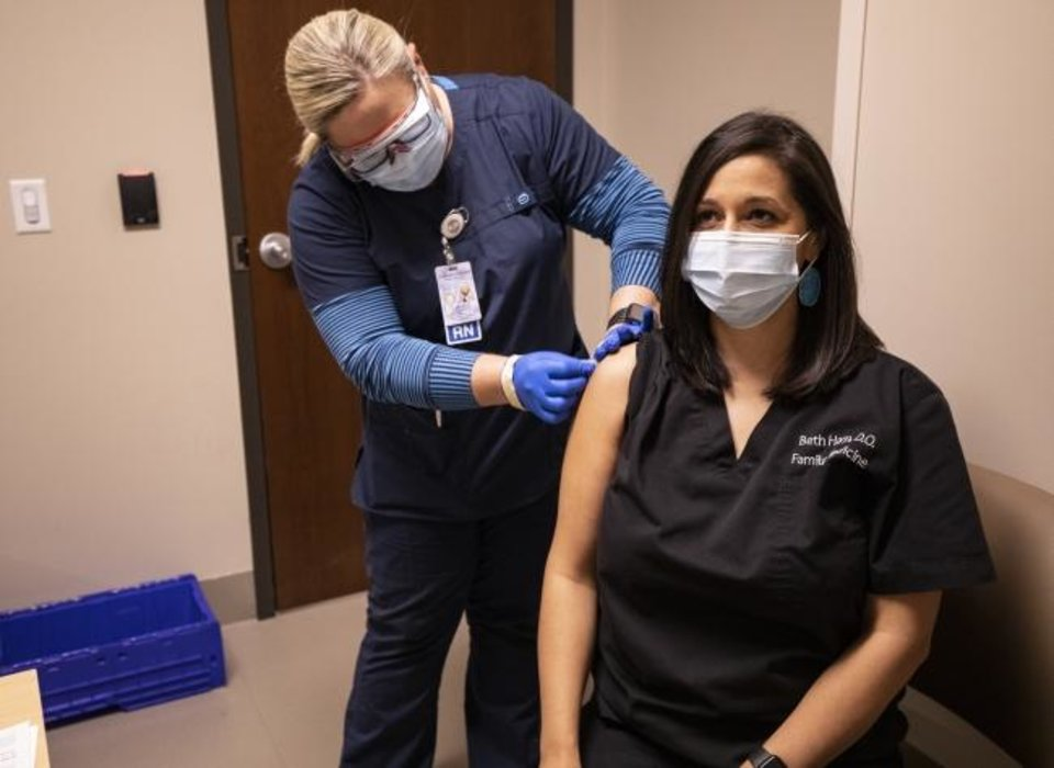 Photo -  Dr. Beth Harp, a Cherokee Nation citizen, receives one of the tribe's first doses of the COVID-19 vaccine Monday, Dec. 14. Photo provided