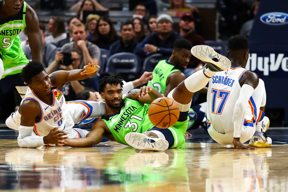 Photo - Jan 25, 2020; Minneapolis, Minnesota, USA; Oklahoma City Thunder guard Hamidou Diallo (6) and Minnesota Timberwolves forward Keita Bates-Diop (31) battle for a loose ball in the first quarter at Target Center. [David Berding/USA TODAY Sports]