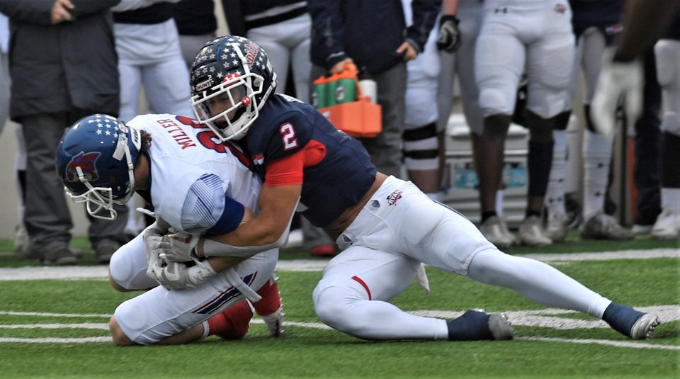 Photo -  Denton Ryan star and OU signee Billy Bowman Jr. makes a tackle in a Texas Region I-5A Division I semifinal game in 2019 against Cooper. [Joey D. Richards/Abilene Reporter-News]