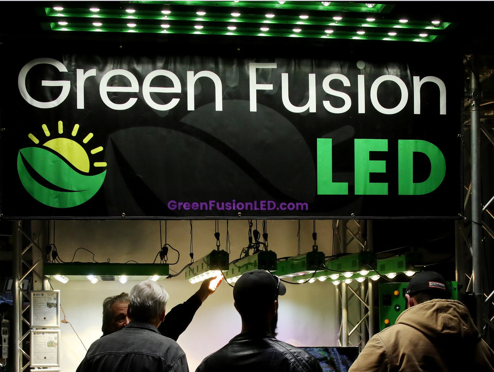 Photo - Green Fusion LED grow lights booth at the Green Grow Expo at State Fair Park, Saturday, March 2, 2019.  Photo by Doug Hoke, The Oklahoman