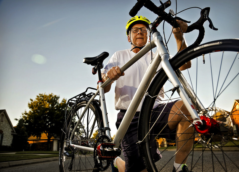 Photo - Oklahoma City Ward 5 city councilman David Greenwell poses for a photo with his bike on Wednesday, Oct. 14, 2015, in Oklahoma City, Okla.  Greenwell is advocating for more bike lanes to be put throughout the city. Photo by Chris Landsberger, The Oklahoman