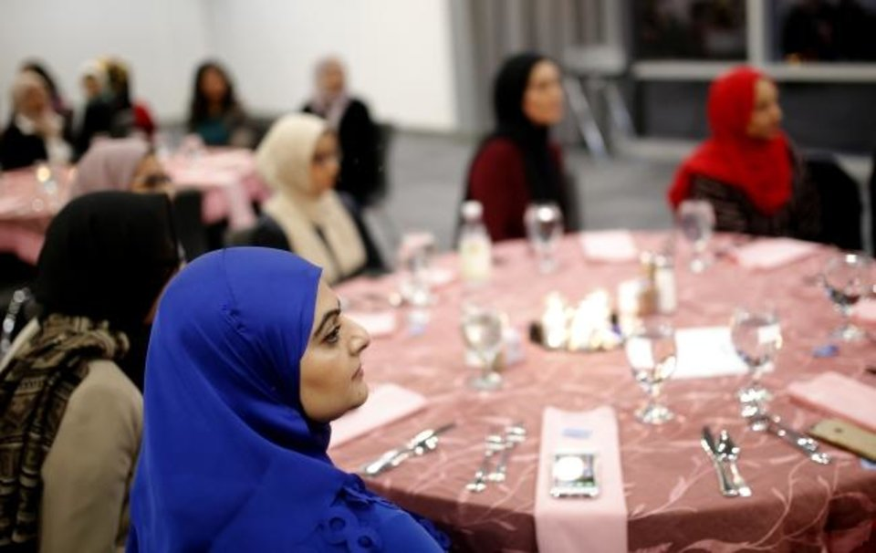 Photo -  Women listen to a guest speaker during a