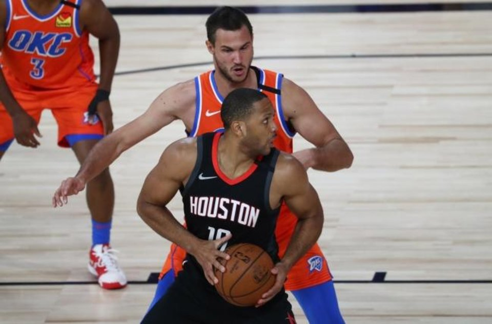 Photo -  Rockets guard Eric Gordon (10) drives to the basket against Thunder forward Danilo Gallinari (8) in the second half of Houston's Game 1 win Tuesday in Lake Buena Vista, Fla. [Kim Klement/USA TODAY Sports]