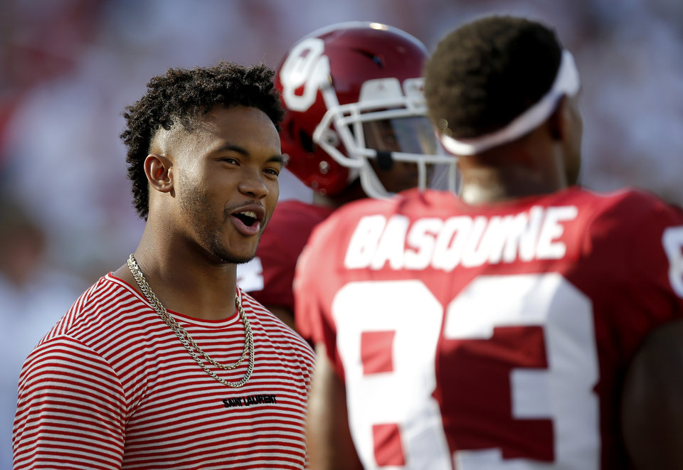 Photo - Kyler Murray talks with Oklahoma's Nick Basquine (83) during a college football game between the University of Oklahoma Sooners (OU) and the Houston Cougars at Gaylord Family-Oklahoma Memorial Stadium in Norman, Okla., Sunday, Sept. 1, 2019. [Sarah Phipps/The Oklahoman]
