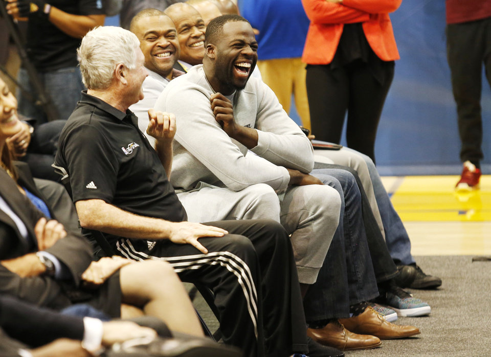 Photo - Golden State Warriors' Draymond Green laughs during as Kevin Durant is introduced during a news conference at the NBA basketball team's practice facility, Thursday, July 7, 2016, in Oakland, Calif.