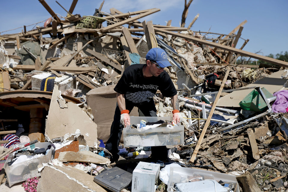 Photo - Adam Brock searches through what is left of his home on Kings Manor in Moore, Okla., Wednesday, May 22, 2013. A tornado damage the area on Monday, May 20, 2013. Photo by Bryan Terry, The Oklahoman