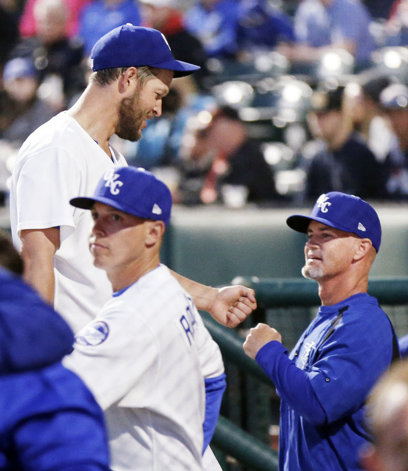 Photo - Clayton Kershaw, left, bumps fists with Oklahoma City manager Travis Barbary after pitching the fourth inning during a minor league baseball game between the San Antonio Missions and the Oklahoma City Dodgers at the Chickasaw Bricktown Ballpark in Oklahoma City, Thursday, April 4, 2019. Kershaw pitched four and a third innings in the rehab start for Oklahoma City. Photo by Nate Billings, The Oklahoman