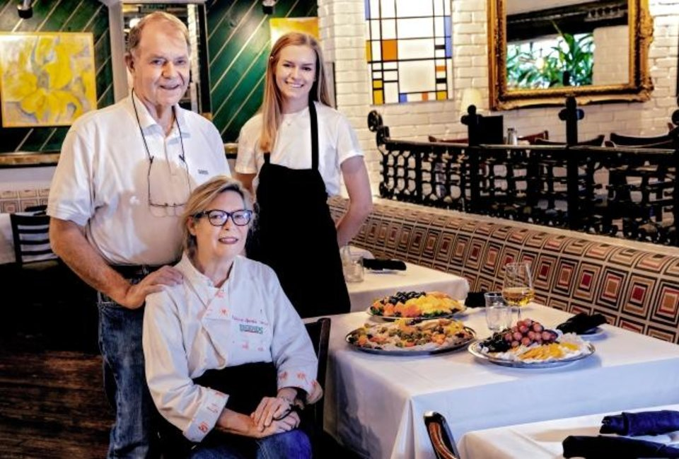 Photo -  Owner Joe Sparks with wife Rebbeca and daughter Eva pose for a photo in the dining room at Legend's Restaurant in Norman, Okla. on Friday, Oct. 23, 2020. Legend's is preparing to reopen its dining room for the first time since April for its annual Thanksgiving feast. [Chris Landsberger/The Oklahoman]