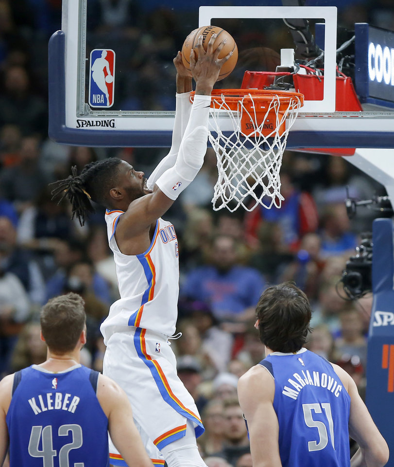 Photo - Oklahoma City's Nerlens Noel (9) dunks the ball during an NBA basketball game between the Oklahoma City Thunder and the Dallas Mavericks at Chesapeake Energy Arena in Oklahoma City, Tuesday, Dec. 31, 2019. Oklahoma City won 106-101. [Bryan Terry/The Oklahoman]