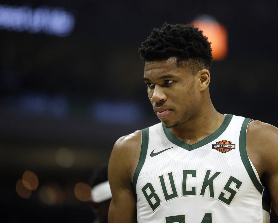 Photo -  Milwaukee's Giannis Antetokounmpo is averaging 26.6 points, 12.6 rebounds and 5.9 assists per game this season and is one of the early front-runners to be league MVP. [AP PHOTO]