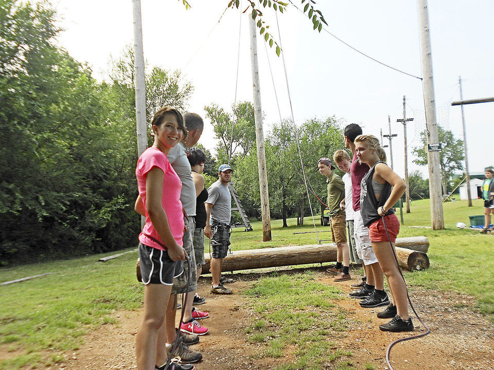 Photo - Teens at Mission Academy attempt a ropes course at Shiloh Camp in Oklahoma City. Photo provided.