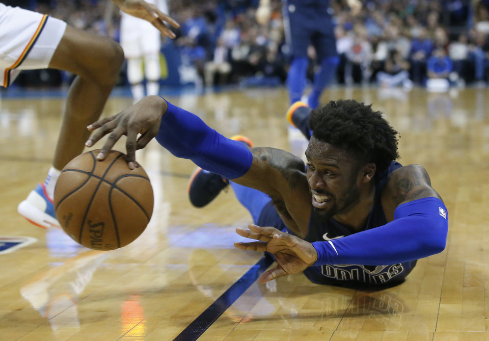 Photo - Dallas Mavericks guard Wesley Matthews reaches for the ball in the second half of an NBA basketball game against the Oklahoma City Thunder in Oklahoma City, Monday, Dec. 31, 2018. (AP Photo/Sue Ogrocki)