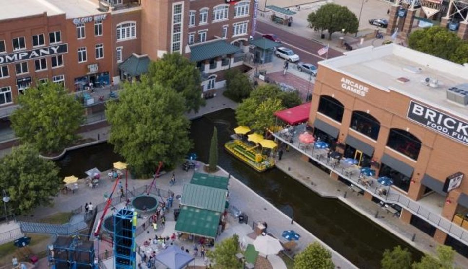 Photo -  Brickopolis, which opened three years ago, added an arcade, laser tag, two restaurants, miniature golf, a climbing wall, bungee jumping and other entertainment to the mix along the Bricktown Canal. [Dave Morris/The Oklahoman]