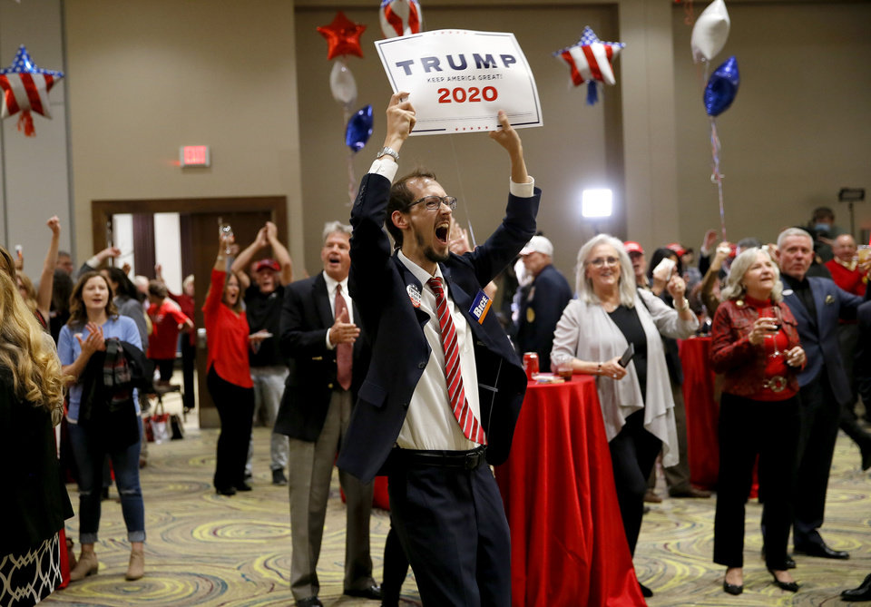 Photo - Ryan Hill cheers during a Republican Party election night watch party in Edmond, Tuesday, Nov. 3, 2020. [Bryan Terry/The Oklahoman]