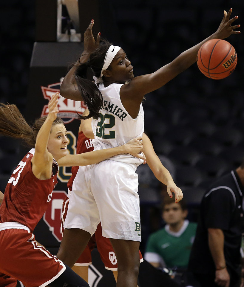 Photo - Oklahoma's Maddie Manning (23) and Baylor's Beatrice Mompremier (32) try to grab a rebound during a semifinal game in the Big 12 Women's Basketball Championship between the Oklahoma Sooners (OU) and the Baylor Lady Bears at Chesapeake Energy Arena in Oklahoma City, Sunday, March 6, 2016. Baylor won 84-57. Photo by Nate Billings, The Oklahoman