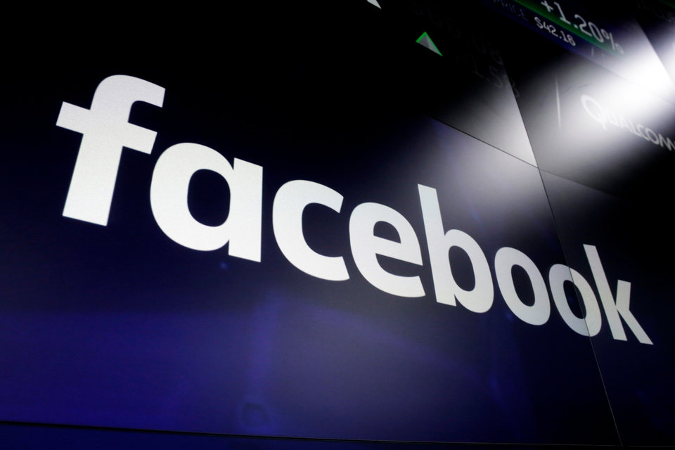 Photo -  FILE - In this March 29, 2018 file photo shows the logo for Facebook at the Nasdaq MarketSite, in New York's Times Square.  Facebook on Friday, Feb. 14, 2020,  decided to allow a type of paid political message that sidesteps many of the social network's rules governing political ads.  Its policy change comes days after presidential candidate Michael Bloomberg exploited a loophole to run such humorous messages promoting his campaign on the accounts of popular Instagram personalities followed by millions of young voters.(AP Photo/Richard Drew, File)