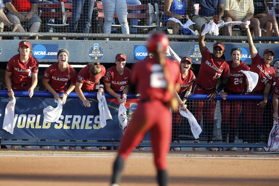 Photo - Oklahoma players celebrate after Sydney Romero hit a double in the first inning of the second NCAA softball game in the championship series of the Women's College World Series between Oklahoma and UCLA at USA Softball Hall of Fame Stadium in Oklahoma City, Tuesday, June 4, 2019. [Bryan Terry/The Oklahoman]