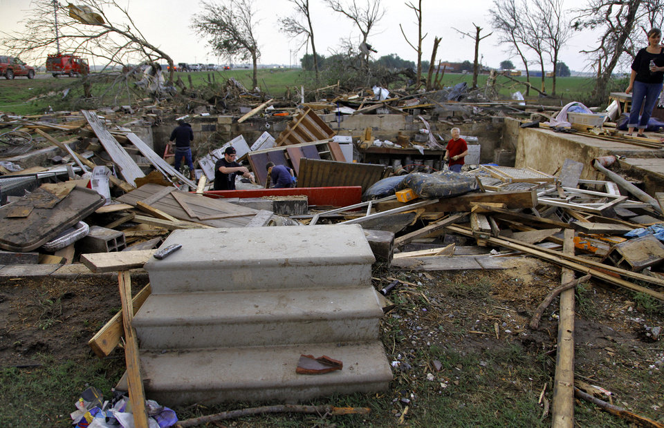 Photo - Steps are one of the few things left after a tornado destroyed the home of Tom Chronister north of El Reno, Tuesday, May 24, 2011. Photo by Chris Landsberger, The Oklahoman ORG XMIT: KOD