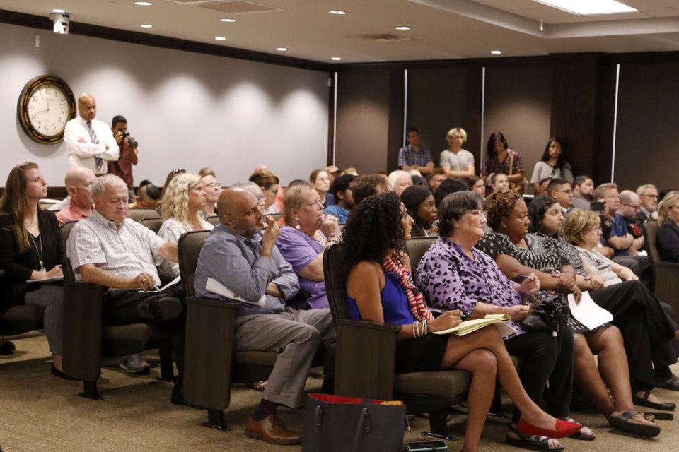 Photo -  Attendees listen during the Oklahoma County Jail Trust meeting in Oklahoma City. [Paxson Haws/The Oklahoman]