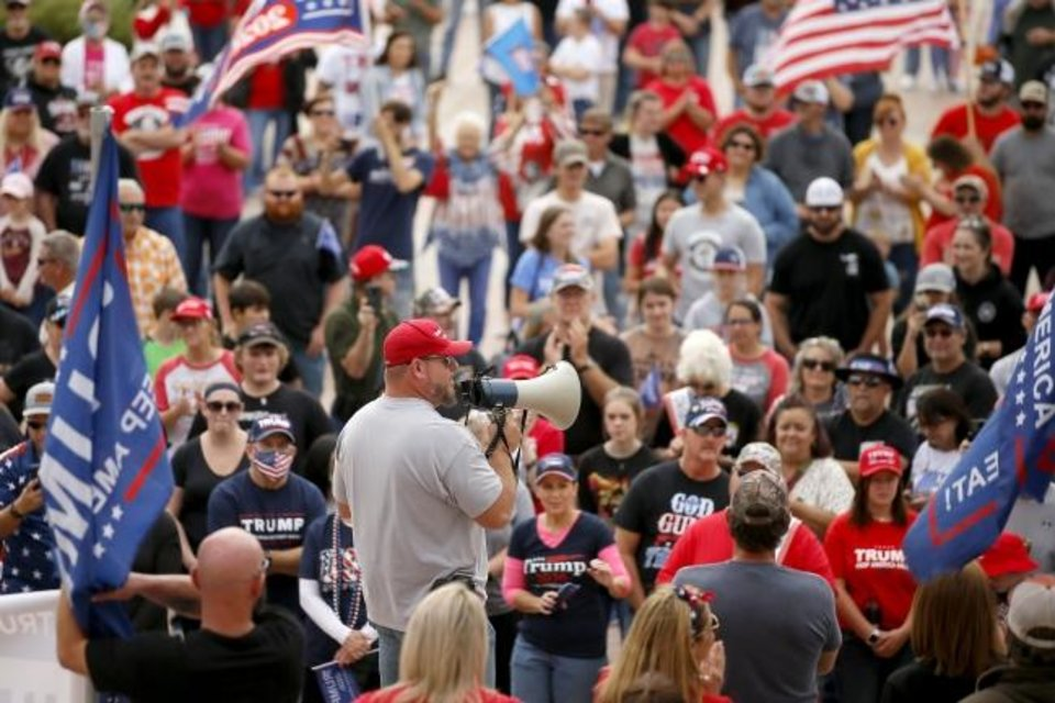 Photo -  Jerry Adams speaks to President Donald Trump supporters Saturday. [Bryan Terry/The Oklahoman]